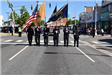 Honor Guard Marching in the Street with Flags