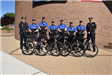 Bicycle Unit pose for a Group Photo with Bikes