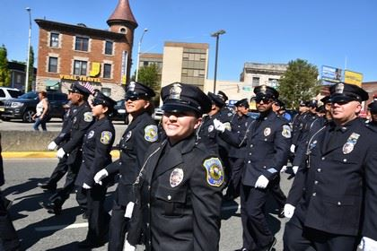 Officers March in the Street for the Memorial Day Parade